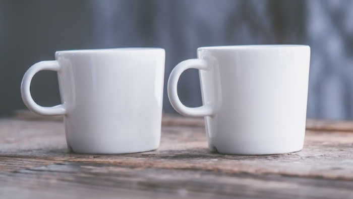 in-person networking coffee cups